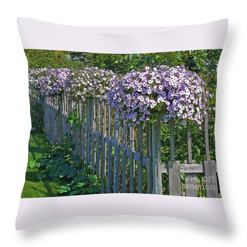 Petunia Throw Pillow featuring the photograph On The Fence by Ann Horn