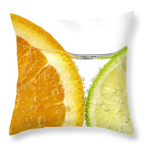 Orange Throw Pillow featuring the photograph Orange and lime slices in water by Elena Elisseeva