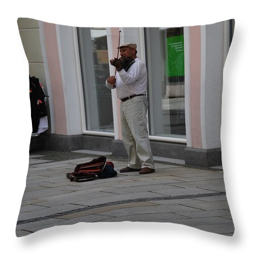 Violin Throw Pillow featuring the photograph Passau Violinist by Richard Booth