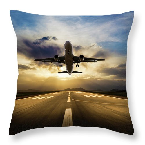 Taking Off Throw Pillow featuring the photograph Passenger Airplane Taking Off At Sunset by Guvendemir
