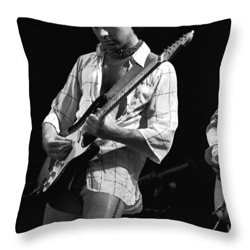 Paul Rodgers Throw Pillow featuring the photograph Paul At Work On His Guitar In 1977 by Ben Upham