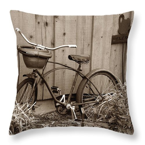Old Bike Throw Pillow featuring the photograph Pedals And Petals by Janice Adomeit