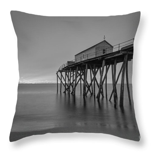 Fishing Pier Sunrise Throw Pillow featuring the photograph Peering Through The Clouds Bw by Michael Ver Sprill