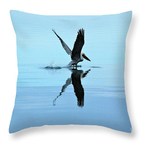 Beach Throw Pillow featuring the photograph Pelican Lift Off by M E Wood