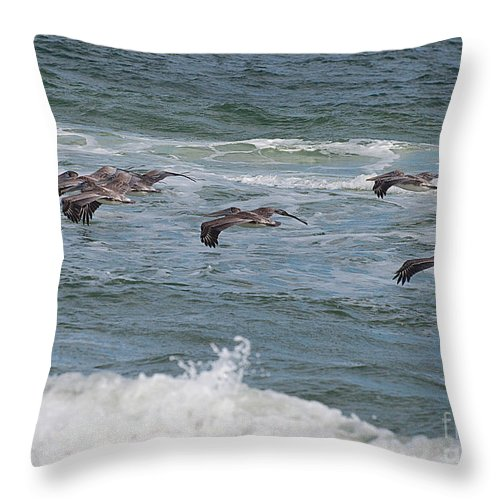 Pelicans Throw Pillow featuring the photograph Pelicans Over The Water by Photos By Cassandra