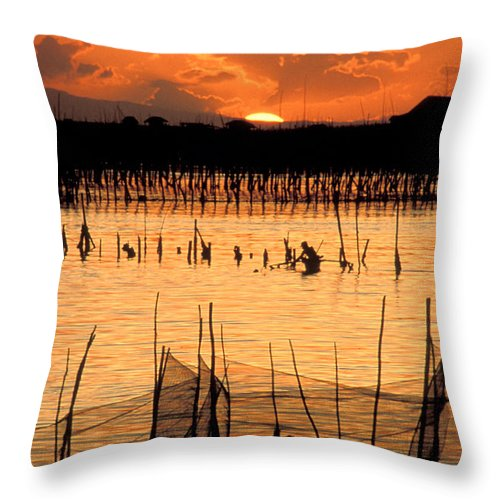Vertical; Outdoors; Sunset; Incidental People; Silhouette; Non Urban Scene; Tranquility; Sea; Fishing; Manila; Philippines; Wading; Fishing Industry; Fishing Net Throw Pillow featuring the photograph Philippines Manila Fishing by Anonymous