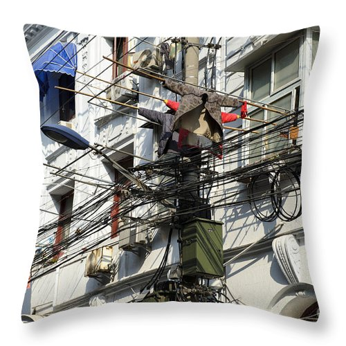 Asia Throw Pillow featuring the photograph Phone Lines And Laundry by John Shaw