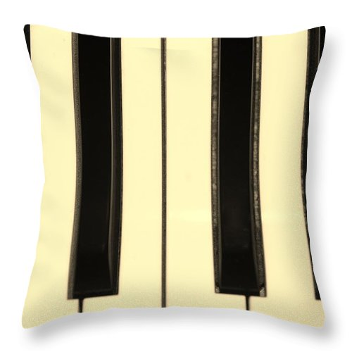 Piano Throw Pillow featuring the photograph Piano Keys In Sepia by Rob Hans
