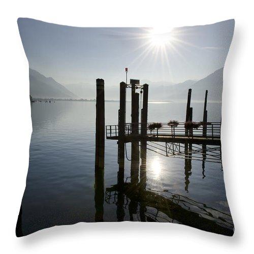 Pier Throw Pillow featuring the photograph Pier On An Alpine Lake by Mats Silvan
