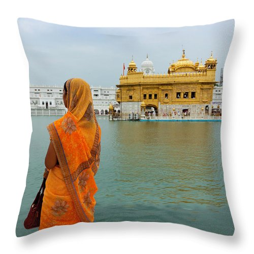 Indian Subcontinent Ethnicity Throw Pillow featuring the photograph Pilgrim In Golden Temple Amritsar, India by Prognone