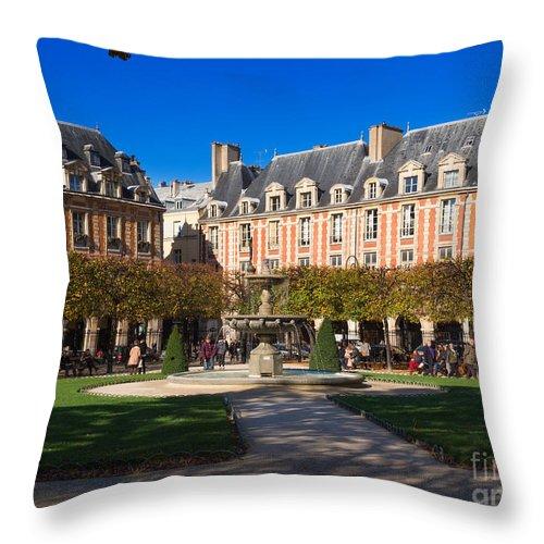 Place Des Vosges Throw Pillow featuring the photograph Place Des Vosges Paris by Louise Heusinkveld