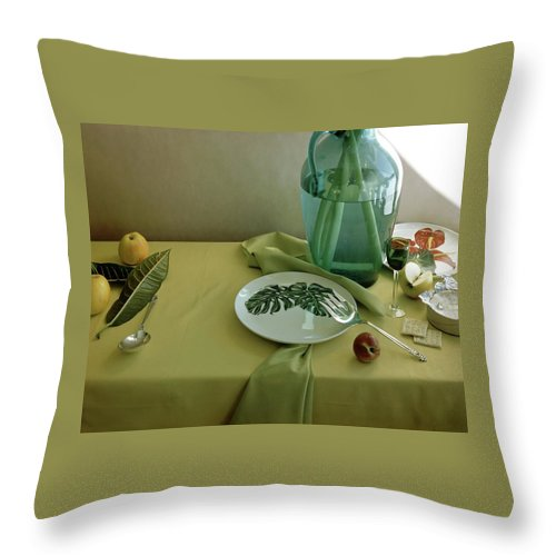 Table Setting Throw Pillow featuring the photograph Plates, Apples And A Vase On A Green Tablecloth by Horst P. Horst