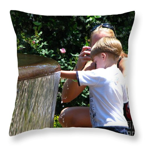 Art For The Wall...patzer Photography Throw Pillow featuring the photograph Playing In Water by Greg Patzer
