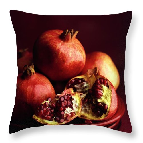 Fruits Throw Pillow featuring the photograph Pomegranates by Romulo Yanes