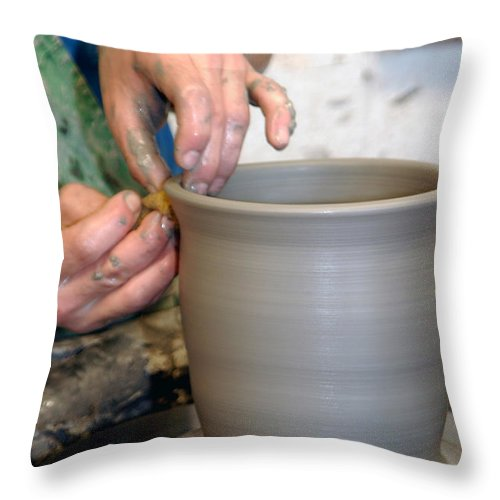 Pottery Throw Pillow featuring the photograph Potters Hands by Susan Leavines Harris