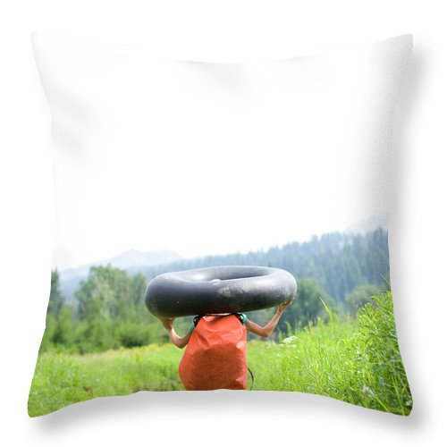 Anticipation Throw Pillow featuring the photograph Pre Teen Girl Carrying An Inner Tube by Woods Wheatcroft