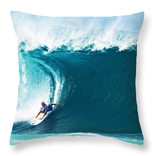 Kelly Slater Throw Pillow featuring the photograph Pro Surfer Kelly Slater Surfing In The Pipeline Masters Contest by Paul Topp