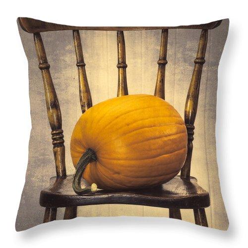 Pumpkins Throw Pillow featuring the photograph Pumpkin On Chair by Amanda Elwell