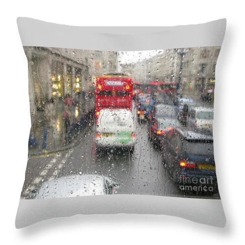 London Throw Pillow featuring the photograph Rainy Day London Traffic by Ann Horn