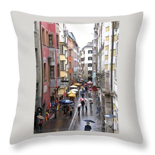 Innsbruck Throw Pillow featuring the photograph Rainy Day Shopping by Ann Horn