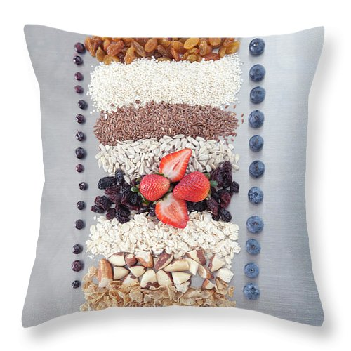 Nut Throw Pillow featuring the photograph Raw Nuts, Fruit And Grains by Laurie Castelli
