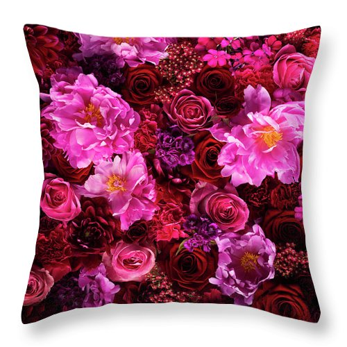 Tranquility Throw Pillow featuring the photograph Red And Pink Cut Flowers, Close Up by Jonathan Knowles