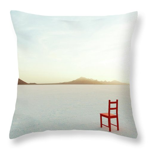Tranquility Throw Pillow featuring the photograph Red Chair On Salt Flats, Facing The by Andy Ryan