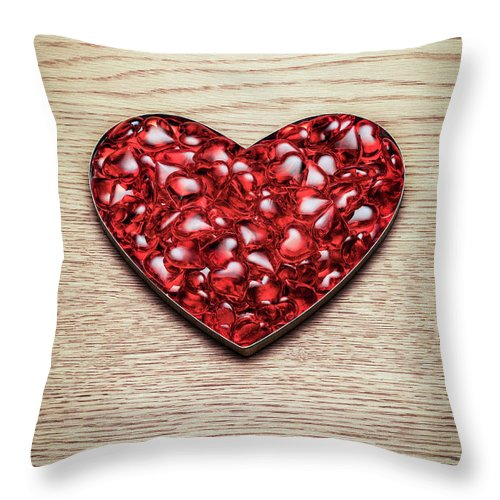 Large Group Of Objects Throw Pillow featuring the photograph Red Hearts In A Heart Shape by Jonathan Kitchen
