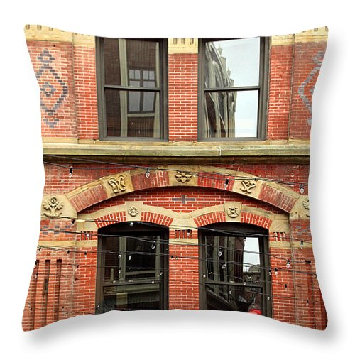Brick Throw Pillow featuring the photograph Red Jacket by Beth Johnston