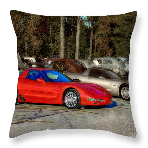 2003 Throw Pillow featuring the photograph Red Ones Are Faster by Michael Rankin