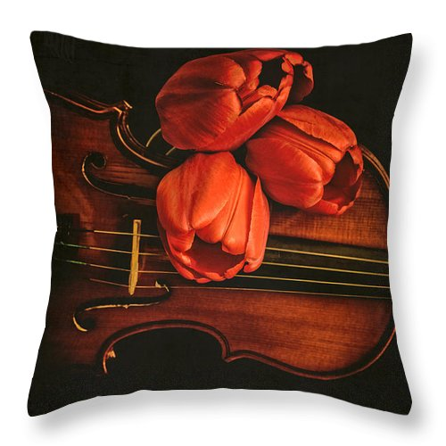 Music Throw Pillow featuring the photograph Red Tulips On A Violin by Edward Fielding