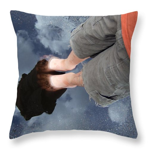 Reflection Throw Pillow featuring the photograph Reflection Of Boy In A Puddle Of Water by Matthias Hauser