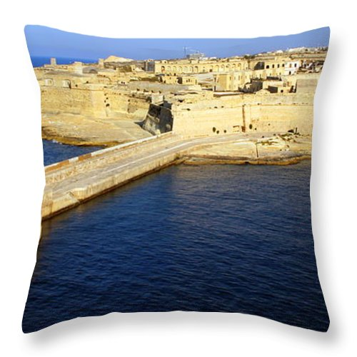 Ricasoli Throw Pillow featuring the photograph Ricasoli Breakwater At Valletta's Grand Harbor by Laurel Talabere