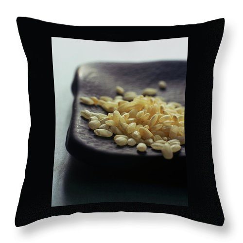 Grains Throw Pillow featuring the photograph Rice On A Black Plate by Romulo Yanes