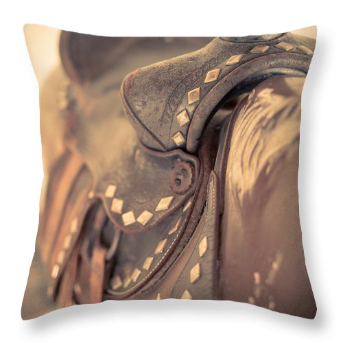 Saddle Throw Pillow featuring the photograph Riding The Saddle Again by Edward Fielding