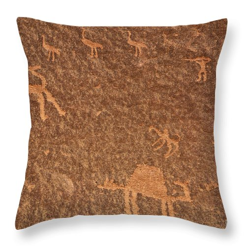 Petroglyph Throw Pillow featuring the photograph Rock Art At Wadi Rum In Jordan by Robert Preston