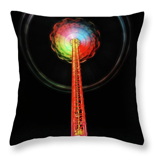 Wiesn Throw Pillow featuring the photograph Round And Round by Hannes Cmarits