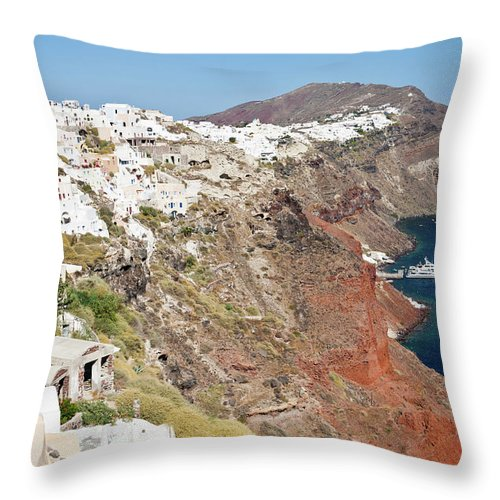 Tranquility Throw Pillow featuring the photograph Rows Of Houses Perch On Cliff In Oia by Melissa Tse