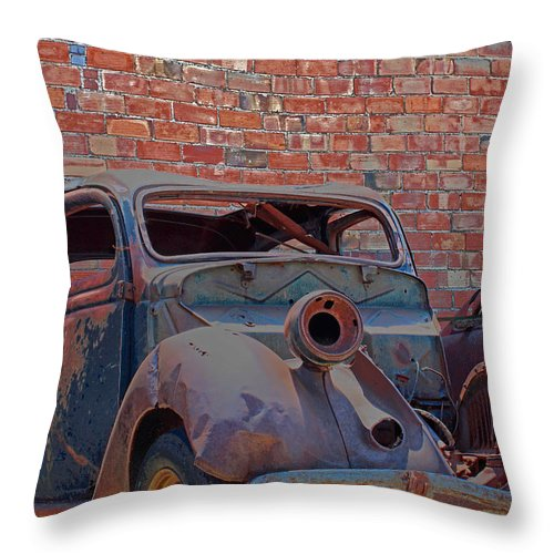 Bricks Throw Pillow featuring the photograph Rust In Goodland by Lynn Sprowl