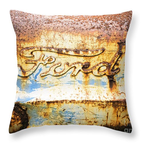 Ford Throw Pillow featuring the photograph Rusty Old Ford Closeup by Edward Fielding