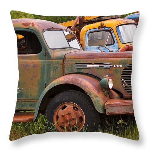 Truck Throw Pillow featuring the photograph Rusty Old Trucks by Louise Heusinkveld