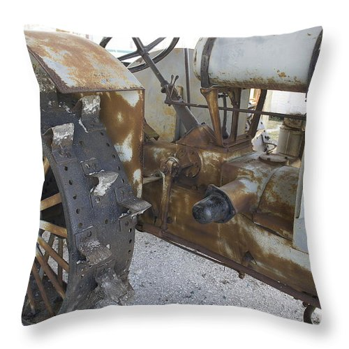 Tractor Throw Pillow featuring the photograph Rusty Tractor by Laurie Perry