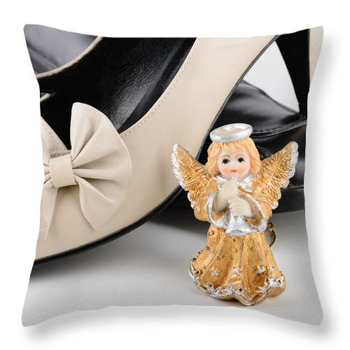 Angel Throw Pillow featuring the photograph Saint Valentine Angel With Two Shoes by Alain De Maximy