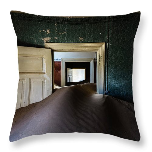 Sand Dune Throw Pillow featuring the photograph Sand Dune In Door Frame Of Abandoned by Pixelchrome Inc