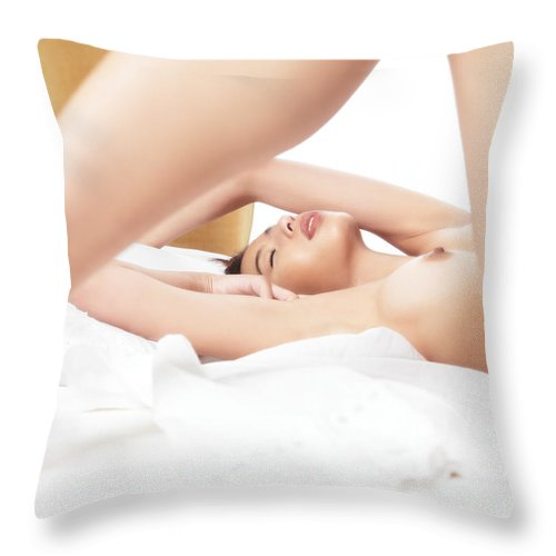 Naked Throw Pillow featuring the photograph Sensual Closeup Of A Naked Woman Lying In Bed by Oleksiy Maksymenko