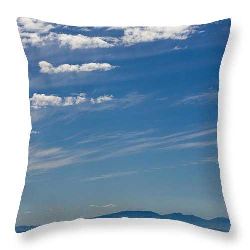 Blue Sky Throw Pillow featuring the photograph Blue Skies And Bluer Seas by Alanna DPhoto