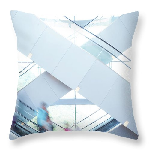 Buy Throw Pillow featuring the photograph Shopers In Motion by Uschools