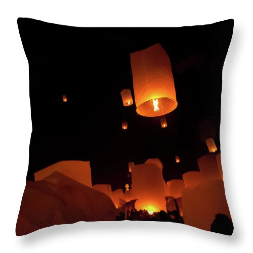 Releasing Throw Pillow featuring the photograph Silhouettes Of People And Dim Lighting by Chrispecoraro