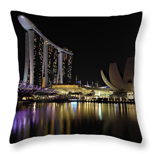 Artscience Throw Pillow featuring the photograph Helix Bridge To Marina Bay Sands by Paul Fell