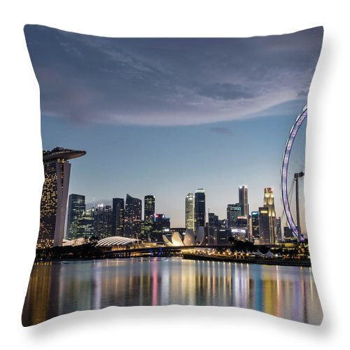 Built Structure Throw Pillow featuring the photograph Singapore Skyline At Dusk by Martin Puddy